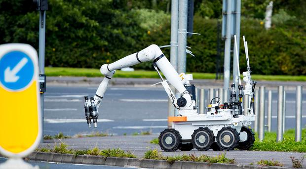 An ATO robot deals with a suspect object at the gates of Belfast Met on the Springfield road in west Belfast , August 10th 2017 (Photo by Kevin Scott / Belfast Telegraph)
