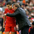 Red alert: Philippe Coutinho (left) and Brendan Rodgers. Photo: Peter Byrne/PA