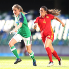 On the charge: Northern Ireland's Leyla McFarland is pursued by Spain's Andrea Maddalen Sierra Larrauri at Windsor Park. Photo: Presseye