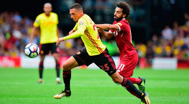 Jose Holebas of Watford and Mohamed Salah of Liverpool battle for possession during the Premier League match between Watford and Liverpool at Vicarage Road on August 12, 2017 in Watford, England. (Photo by Tony Marshall/Getty Images)