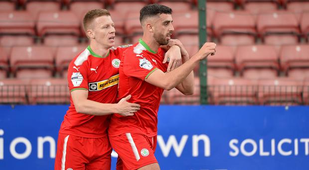 Cliftonville's Joe Gormley celebrates after he slots home to make the score 2-1