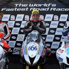 Bruce Anstey (Second) Peter Hickman (Winner) and Lee Johnston (Third) celebrate at the Ulster Grand Prix.