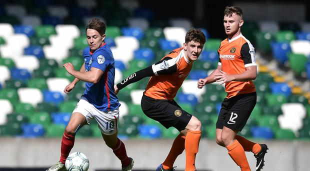 Linfield's Jordan Stewart was a step ahead of the Carrick defence.