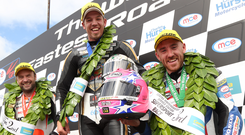 Man of the moment: Peter Hickman (centre) celebrates winning the UGP 1st Supersport race with runner up Bruce Anstey (left) and third placed Lee Johnston