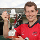 Waringstown captain Craig Thompson celebrates winning the Ulster Cup in 2017.