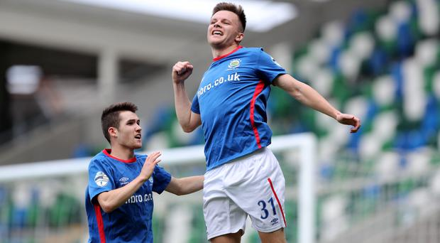 In the groove: Paul Smyth is the first to congratulate Niall Quinn on his goal against Carrick Rangers