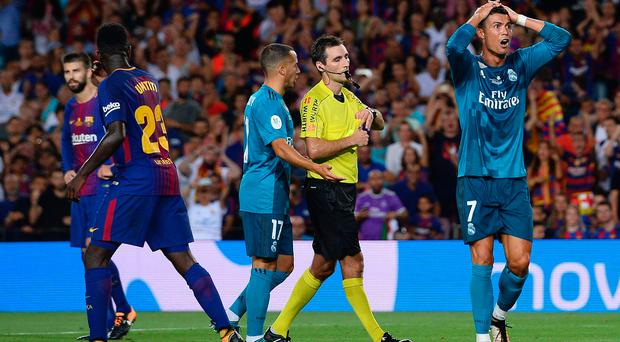 Red mist: Real Madrid's Cristiano Ronaldo reacts after being sent off by referee Ricardo de Burgos Bengoetxea