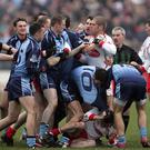 Gripping stuff: Ryan McMenamin on the ground and Kevin Hughes in the midst in the 'Battle of Omagh' in 2006. Photo: /Morgan Treacy/INPHO