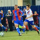 Linfield's Paul Smyth and Ards Johnny Taylor during this evening's game at Bangor Arena, Bangor.