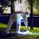 Police and forensics at the scene of a punishment shooting in the Henry Place area of North Belfast on July 22nd 2017 (Photo by Kevin Scott / Belfast Telegraph)