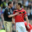 Best of enemies: Back in the day, Jamie Carragher and Gary Neville spent most of their time bickering and arguing. No change there then