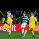 Halfway there: Leigh Griffiths' shot deflects off Igor Shitov and into the back of the net to complete rampant Celtic's scoring last night