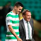 Five-star: Manager Brendan Rodgers and Celtic's Tom Rogic