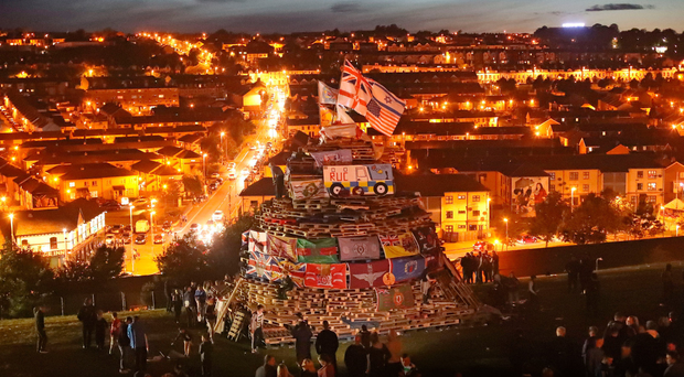 Flags and poppy wreaths on a bonfire in the Bogside on Tuesday night