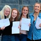 Friends (from left) Anna Murray, Chloe Roberts, Caitlin Lawlor, and Aine Kerr, after collecting their A-level results at Our Lady and Saint Patrick's College, Belfast. Brian Lawless/PA Wire
