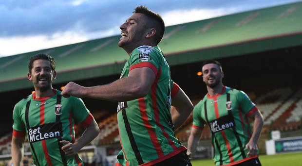 Big goals: John McGuigan celebrates his first strike of the season in the win against Swifts. Photo: Colm Lenaghan/Pacemaker