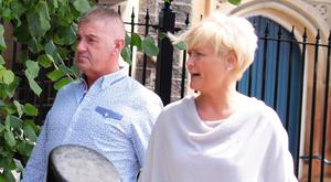 Colin Turton and his partner Heather Ramsey leave Ballymena Magistrates Court yesterday