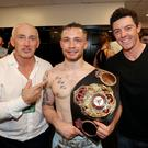 All change: Barry McGuigan, Carl Frampton and Rory McIlroy after the Jackal's victory over Leo Santa Cruz. Photo: William Cherry/Presseye