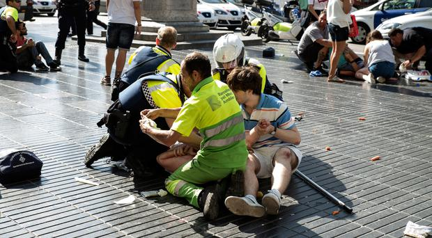 Emergency crews tend to the injured after yesterday's attack