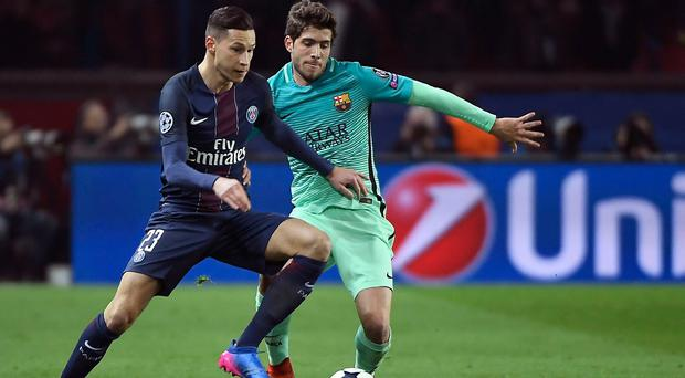 Paris Saint-Germain's German midfielder Julian Draxler (L) is a reported target for Liverpool, Arsenal and Manchester United.