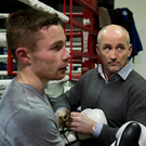 Glove affair: Barry McGuigan gets Carl Frampton ready for a sparring session in 2013