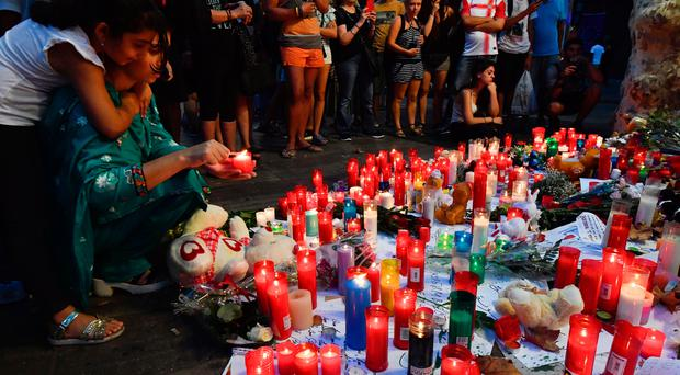 People pay tribute to the victims of the Barcelona attack