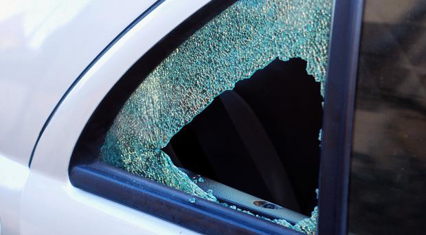 A number of cars were damaged by youths throwing stones. (stock image)