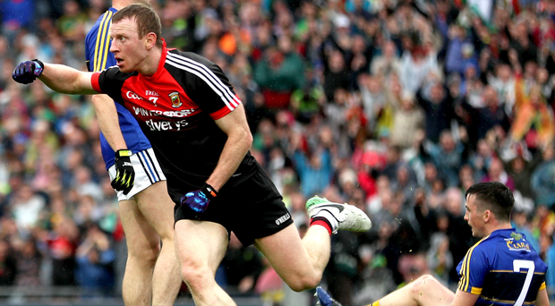 All square: Mayo's Colm Boyle celebrates scoring his side's second goal yesterday
