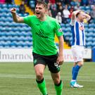 Pitching in: makeshift striker James Forrest celebrates hitting the opener for Celtic