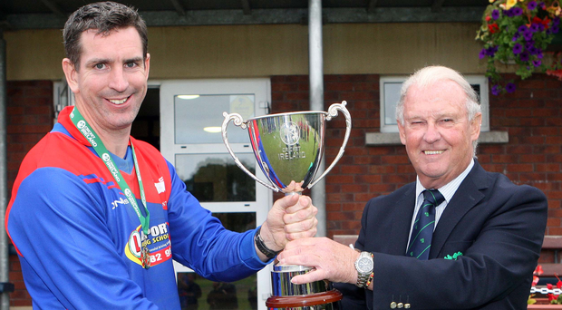 Silver lining: Joe Morrissey, captain of Clontarf, with President of Cricket Ireland Brian Walsh