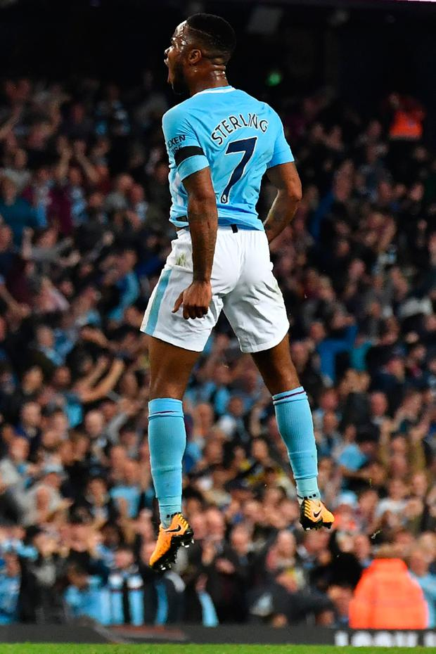 Manchester City's English midfielder Raheem Sterling celebrates scoring his team's first goal during the English Premier League football match between Manchester City and Everton at the Etihad Stadium in Manchester, north west England, on August 21, 2017. / AFP PHOTO / Anthony Devlin / RESTRICTED TO EDITORIAL USE. No use with unauthorized audio, video, data, fixture lists, club/league logos or 'live' services. Online in-match use limited to 75 images, no video emulation. No use in betting, games or single club/league/player publications. / ANTHONY DEVLIN/AFP/Getty Images