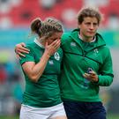 Try-scorer Alison Miller (left) is conforted after defeat to Australia.