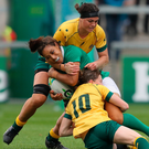 Double trouble: Ireland's Sene Naoupu is tackled by Australian duo Alisha Hewett and Ashleigh Hewson