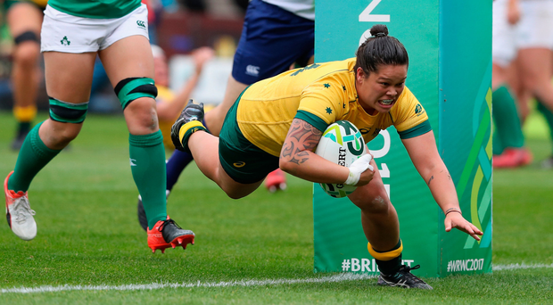 One way: Sarah Riordan of Australia dives over for a try