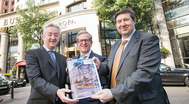 John McGrillen, chief executive of Tourism NI, Europa Hotel manager James McGinn and Michael Williamson, director at ASM Chartered Accountants, and (right) the new Grand Central Hotel