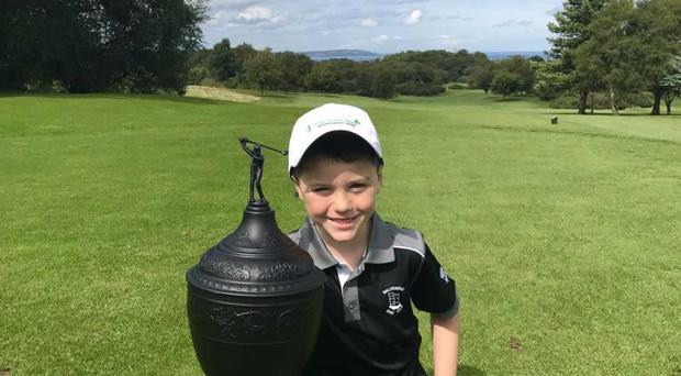 Ollie McEvoy with the Gary Player Trophy.