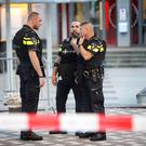 Police stand during the evacuation the Maassilo concert venue after a concert by Californian ban Allah-Las was canceled in relation to a terror attack threat, according to police and the venue, on August 23, 2017, in Rotterdam. / AFP PHOTO / ANP / Arie Kievit / Netherlands OUTARIE KIEVIT/AFP/Getty Images