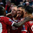 Liverpool's German midfielder Emre Can (2R) celebrates with teammates scoring his team's first goal during the Champions League qualifier, second leg match between Liverpool and Hoffenheim at Anfield stadium in Liverpool on August 23, 2017. / AFP PHOTO / Oli SCARFFOLI SCARFF/AFP/Getty Images