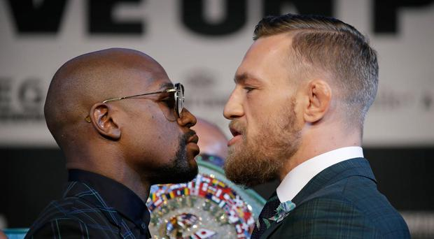 Face to face: Floyd Mayweather (left) and Conor McGregor clash tomorrow night in Las Vegasthrown