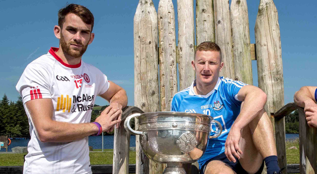 Up for it: Ronan McNamee (left) of Tyrone and Dublin's Ciaran Kilkenny with the Sam Maguire Cup