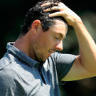 Tough day: Rory McIlroy after struggling in his opening round