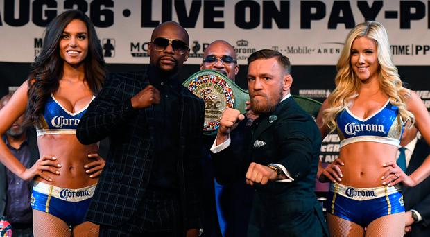 War: Conor McGregor (right) and Floyd Mayweather ready to rock. Photo: Ethan Miller/Getty Images