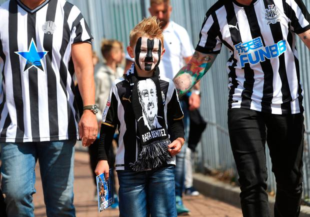 The beautiful game - football fans from around the world - Newcastle United fans arriving before the Premier League match at the Kirklees Stadium, Huddersfield.