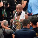 Floyd Mayweather Jnr defeats Conor McGregor during their fight at the T-Mobile Arena, Las Vegas. Lionel Hahn/PA Wire.