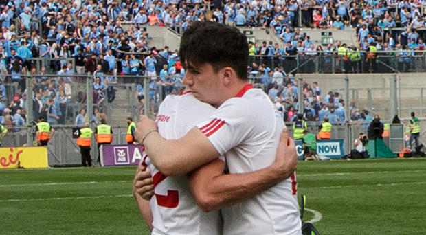 Heavy loss: Tyrone's Darren McCurry and Lee Brennan console each other afterwards at Croke Park