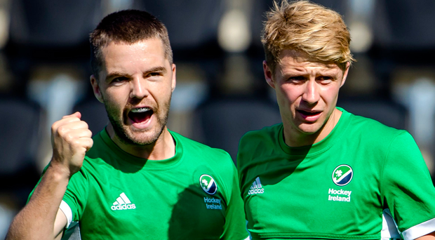 Close shave: Alan Sothern and Neal Glassey celebrate after Ireland's late scare against Austria
