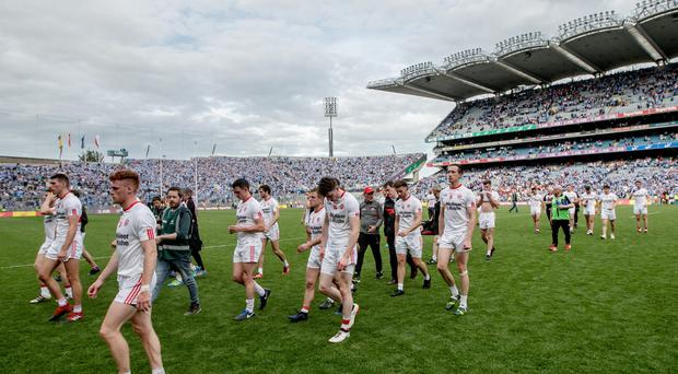 Tyrone players leave the field dejected after the GAA All-Ireland Senior Football Championship Semi-Final, Croke Park, Dublin 27/8/2017 ©INPHO/James Crombie