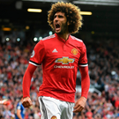 Red roar: Marouane Fellaini celebrates scoring United's second