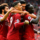 On fire: Sadio Mane celebrates his goal goal with his Liverpool team-mates