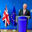 British Secretary of State for Exiting the European Union (Brexit Minister) David Davis (L) and European Union Chief Negotiator in charge of Brexit negotiations with Britain Michel Barnier (R) EMMANUEL DUNANDEMMANUEL DUNAND/AFP/Getty Images